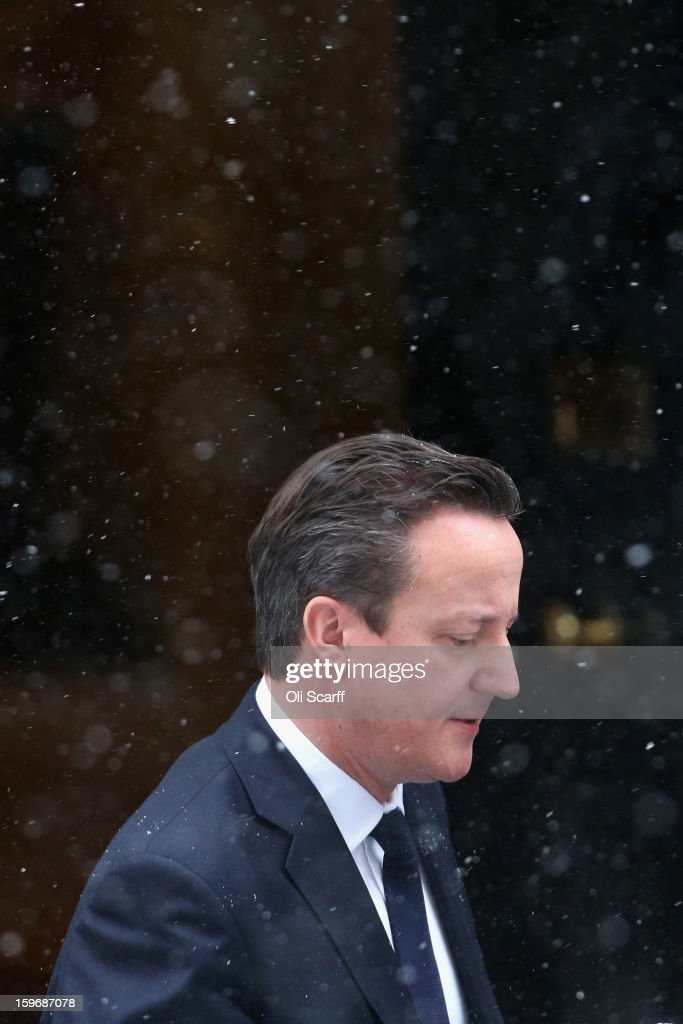 British Prime Minister <a gi-track='captionPersonalityLinkClicked' href=/galleries/search?phrase=David+Cameron+-+Politician&family=editorial&specificpeople=227076 ng-click='$event.stopPropagation()'>David Cameron</a> leaves Number 10 Downing Street to travel to the House of Commons to deliver a statement on the unfolding hostage situation in Algeria on January 18, 2013 in London, England. Islamist militants had claimed to be holding 41 foreigners hostage at a gas treatment plant in the Algerian desert. At least four hostages and several militants were killed yesterday when Algerian troops stormed an area of the plant.
