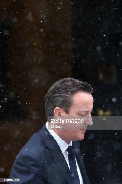 British Prime Minister David Cameron leaves Number 10 Downing Street to travel to the House of Commons to deliver a statement on the unfolding...