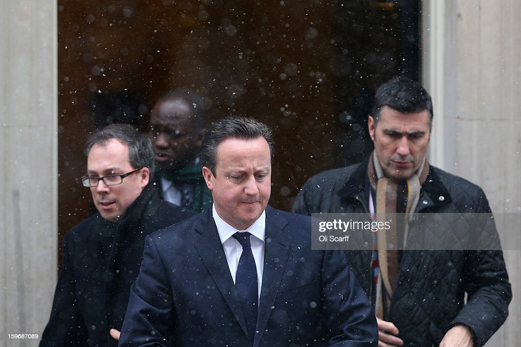 British Prime Minister David Cameron (C) leaves Number 10 Downing Street to travel to the House of Commons to deliver a statement on the unfolding hostage situation in Algeria on January 18, 2013 in London, England. Islamist militants had claimed to be holding 41 foreigners hostage at a gas treatment plant in the Algerian desert. At least four hostages and several militants were killed yesterday when Algerian troops stormed an area of the plant.