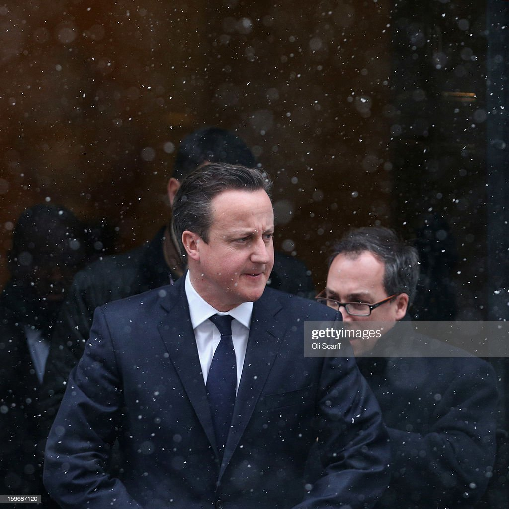 British Prime Minister David Cameron (L) leaves Number 10 Downing Street to travel to the House of Commons to deliver a statement on the unfolding hostage situation in Algeria on January 18, 2013 in London, England. Islamist militants had claimed to be holding 41 foreigners hostage at a gas treatment plant in the Algerian desert. At least four hostages and several militants were killed yesterday when Algerian troops stormed an area of the plant.