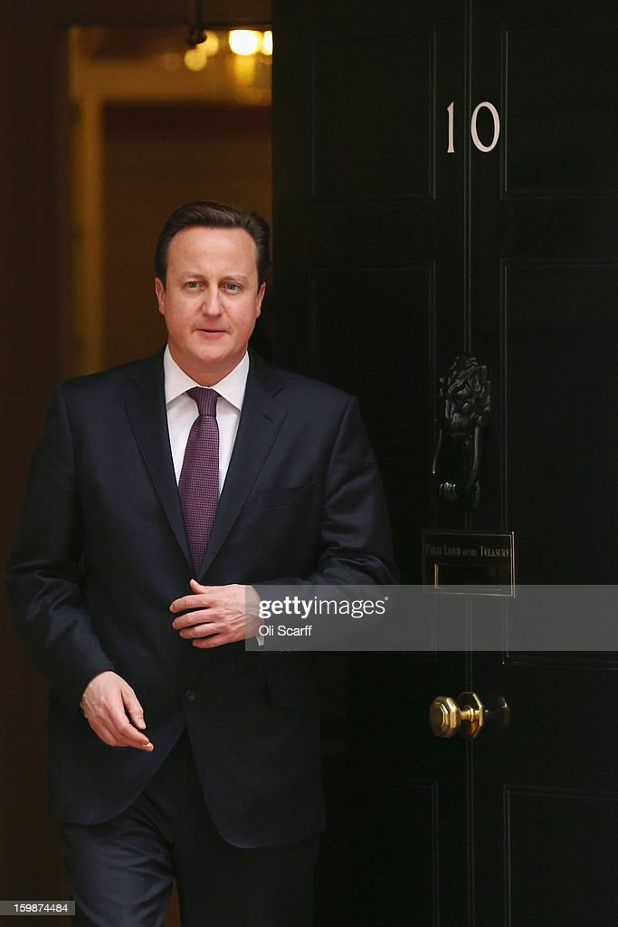 British Prime Minister <a gi-track='captionPersonalityLinkClicked' href=/galleries/search?phrase=David+Cameron+-+Politician&family=editorial&specificpeople=227076 ng-click='$event.stopPropagation()'>David Cameron</a> leaves Number 10 Downing Street to meet the Emir of Qatar, Sheikh Hamad bin Khalifa Al Thani on January 22, 2013 in London, England. During his meeting with Prime Minister Cameron at Downing Street, the Emir of Qatar is expected to discuss the situations in Syria and Iran as well as the Emir's business interests in the UK. Mr Cameron is due to deliver a long-awaited speech on Britain's relationship with the EU tomorrow.