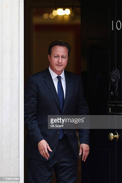 British Prime Minister David Cameron leaves Number 10 Downing Street to greet His Majesty King Abdullah II of Jordan on June 19 2013 in London...