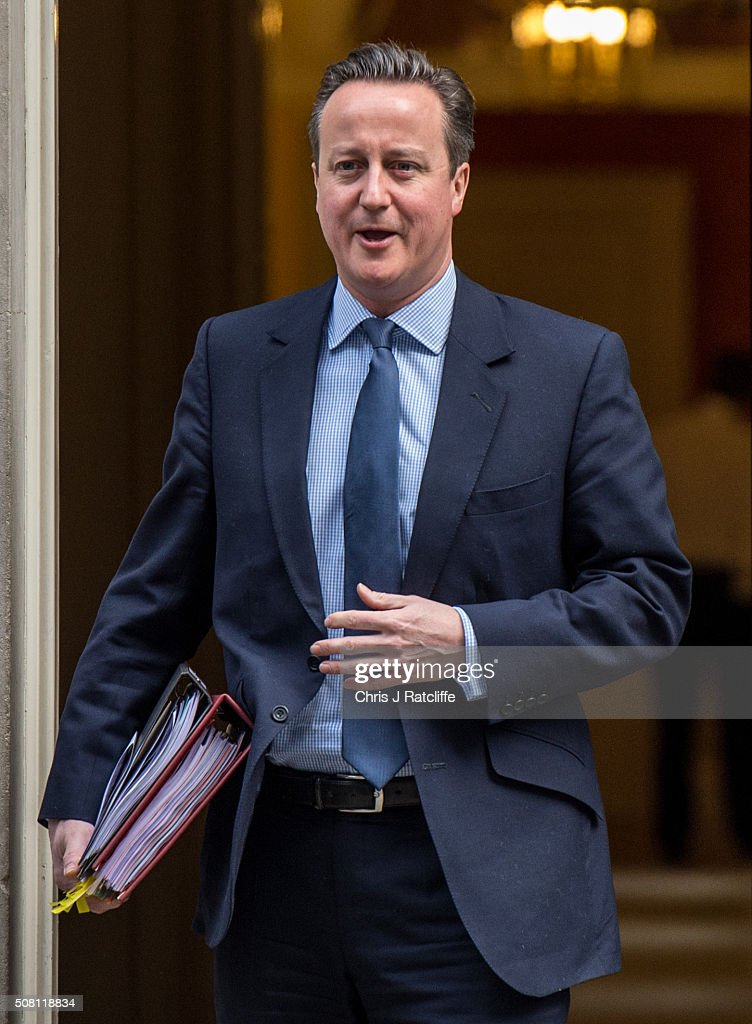 British Prime Minister <a gi-track='captionPersonalityLinkClicked' href=/galleries/search?phrase=David+Cameron+-+Pol%C3%ADtico&family=editorial&specificpeople=227076 ng-click='$event.stopPropagation()'>David Cameron</a> leaves number 10 Downing Street to attend Parliament on February 3, 2016 in London, England. Cameron was on his way to attend Prime Minister's Questions.