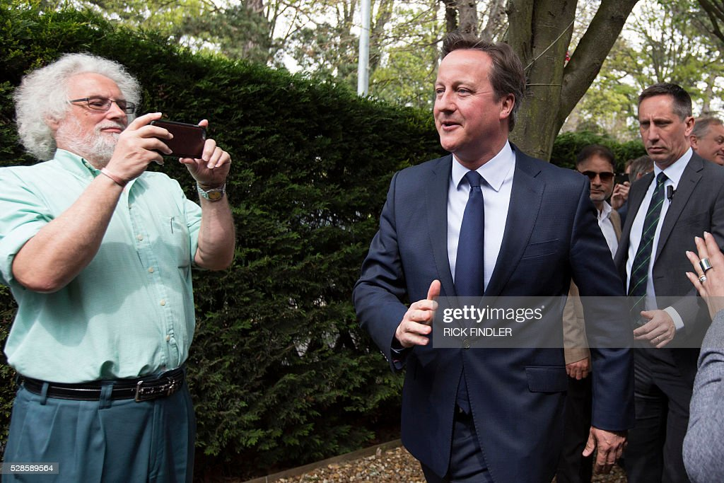 British Prime Minister David Cameron (C) leaves Peterborough Conservative Club in Peterborough, central England, on May 6, 2016, after addressing local councillors following the local elections. Early results Friday from British local and regional elections seen as a key test for opposition Labour leader Jeremy Corbyn showed strong gains for Scottish nationalists, as London looked set to elect its first Muslim mayor. London was on track to become the first EU capital with a Muslim mayor as voters went to the polls Thursday after a bitter campaign between Prime Minister David Cameron's Conservatives and the opposition Labour party. / AFP / POOL / Rick Findler