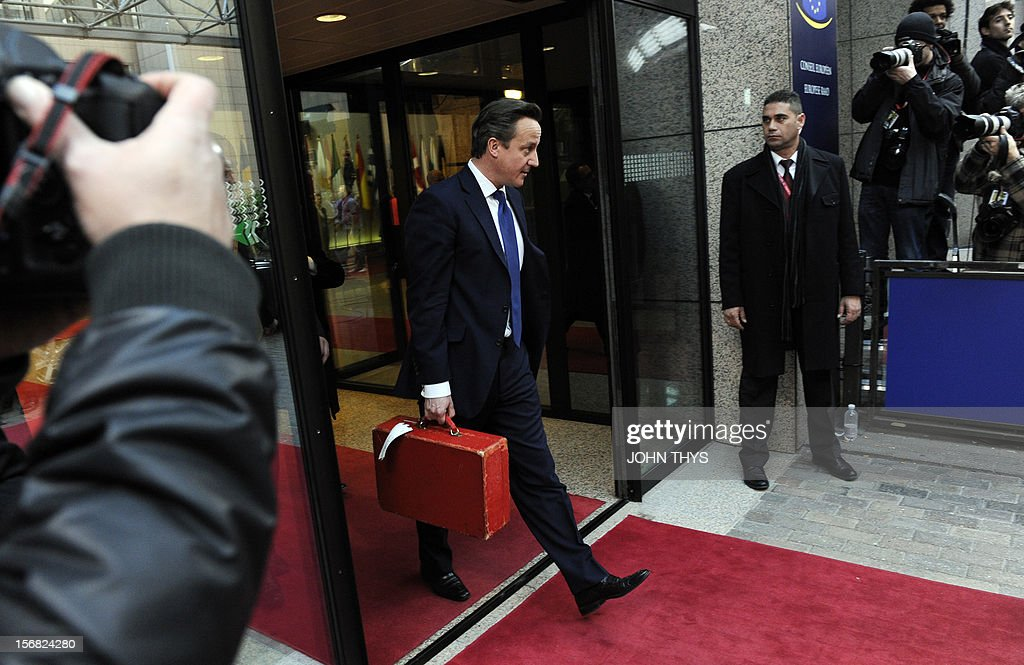 British Prime Minister David Cameron leaves the EU Headquarters on November 22, 2012 in Brussels, during a two-day European Union leaders summit called to agree a hotly-contested trillion-euro budget through 2020. European Union officials were scrambling to find an all but impossible compromise on the 2014-2020 budget that could successfully move richer nations looking for cutbacks closer to poorer ones who look to Brussels to prop up hard-hit industries and regions. AFP PHOTO / JOHN THYS