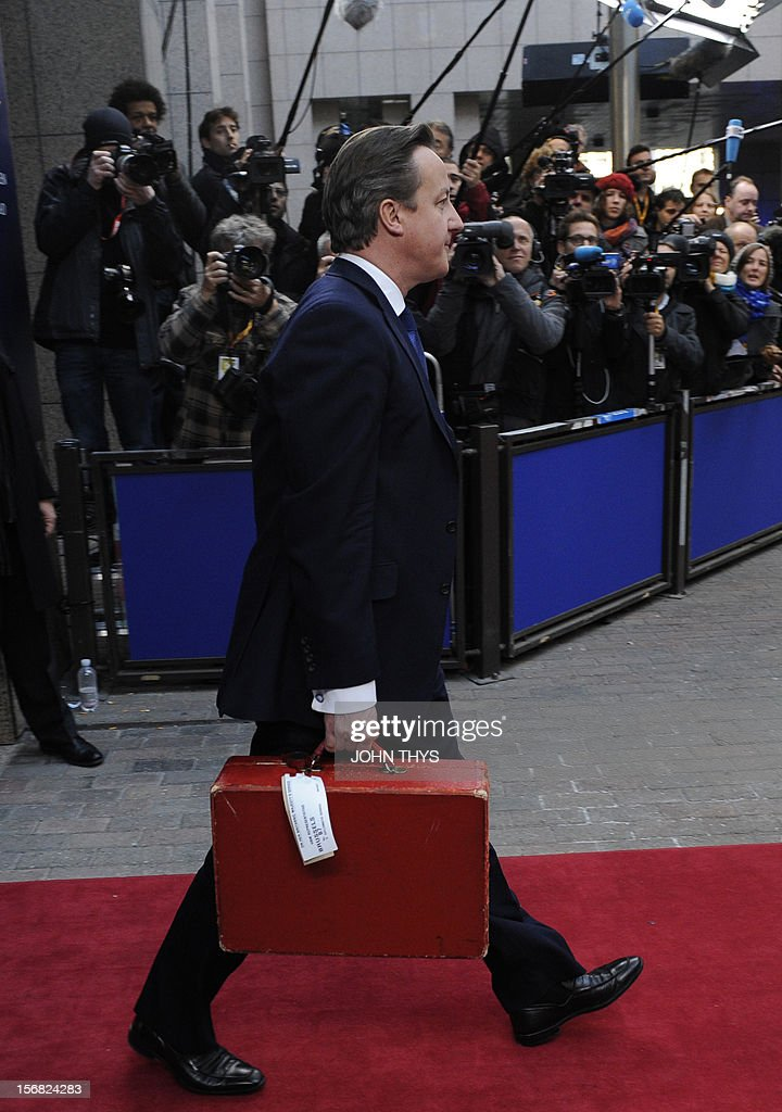 British Prime Minister David Cameron leaves the EU Headquarters on November 22, 2012 in Brussels, during a two-day European Union leaders summit called to agree a hotly-contested trillion-euro budget through 2020. European Union officials were scrambling to find an all but impossible compromise on the 2014-2020 budget that could successfully move richer nations looking for cutbacks closer to poorer ones who look to Brussels to prop up hard-hit industries and regions.