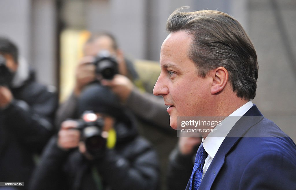 British Prime Minister David Cameron leaves the EU Headquarters on November 22, 2012 in Brussels, during a two-day European Union leaders summit called to agree a hotly-contested trillion-euro budget through 2020. European Union officials were scrambling to find an all but impossible compromise on the 2014-2020 budget that could successfully move richer nations looking for cutbacks closer to poorer ones who look to Brussels to prop up hard-hit industries and regions. AFP PHOTO / GEORGES GOBET