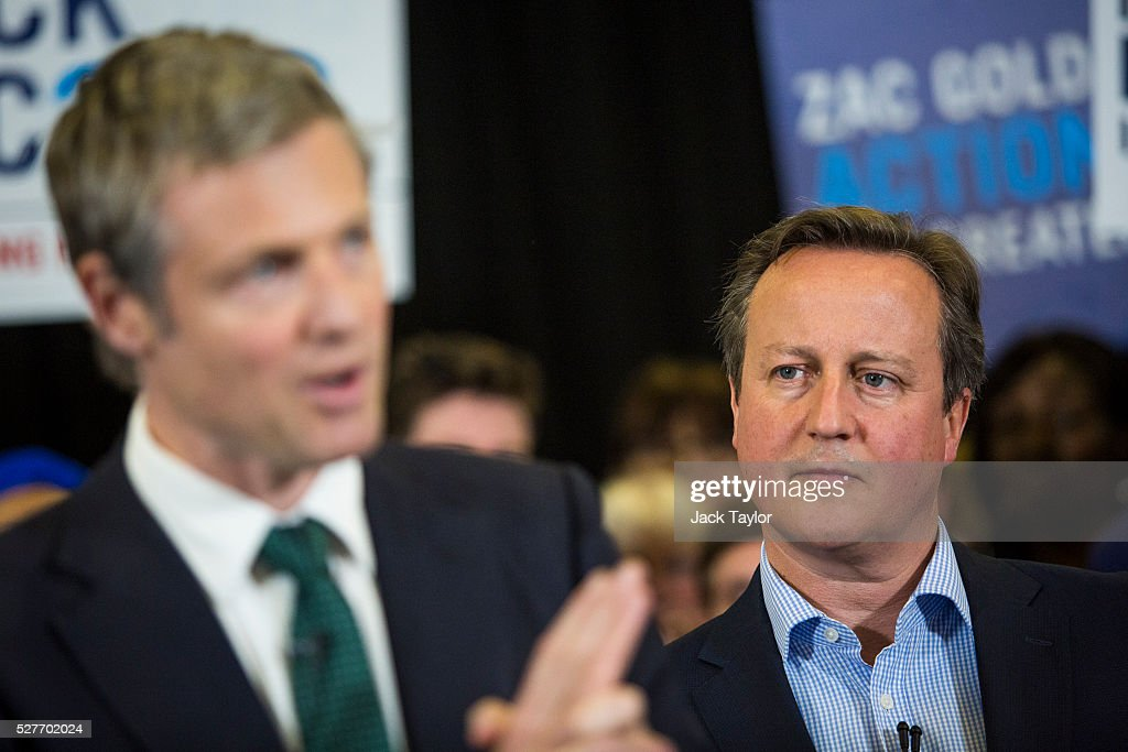 British Prime Minister David Cameron (R) listens as Conservative candidate for Mayor of London, Zac Goldsmith speaks at a mayoral campaign rally at Grey Court School in Richmond on May 3, 2016 in London, England. The Prime Minister joined the Conservative Mayoral candidate at Grey Court School on the penultimate day of campaigning. Former pupils of the school include London's Cycling Commissioner, Andrew Gilligan. Londoners go to the polls on Thursday 5th May with the declaration expected later on Friday 6th. The current Mayor of London is the Conservative MP for Henley, Boris Johnson.