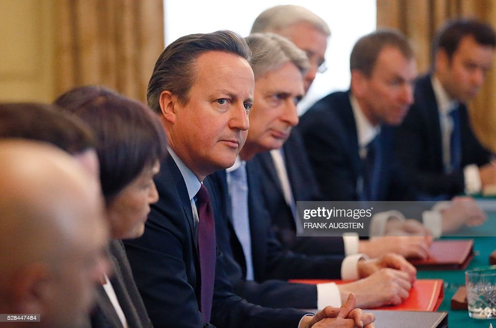 British Prime Minister David Cameron (C) listens during his meeting with Japanese Prime Minister Shinzo Abe (unseen) during their meeting inside 10 Downing Street in central London on May 5, 2016. / AFP / POOL / Frank Augstein