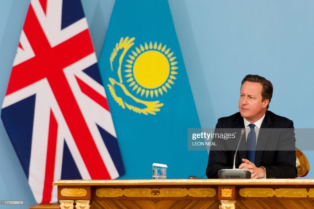 British Prime Minister David Cameron listens to questions during a joint press conference with President Nursultan Nazarbayev (not pictured) after signing a strategic partnership agreement at the Presidential Palace in Astana, Kazakhstan on July 1, 2013. David Cameron arrived in Kazakhstan on June 30, 2013 on the first ever trip by a serving British prime minister, hoping to boost trade ties but also promising to raise human rights concerns. AFP PHOTO/POOL/ LEON NEAL