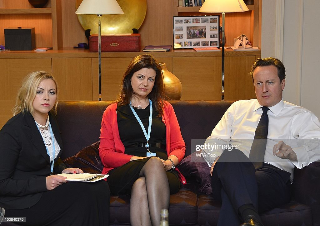 British Prime Minister <a gi-track='captionPersonalityLinkClicked' href=/galleries/search?phrase=David+Cameron+-+Politician&family=editorial&specificpeople=227076 ng-click='$event.stopPropagation()'>David Cameron</a> (R) listens to singer <a gi-track='captionPersonalityLinkClicked' href=/galleries/search?phrase=Charlotte+Church&family=editorial&specificpeople=203217 ng-click='$event.stopPropagation()'>Charlotte Church</a> (L) and former police officer Jacqui Hames (C) during a private meeting at the Conservative Party conference on October 9, 2012 in Birmingham, England. Members of pressure group 'Hacked Off' were seeking a recommitment by Cameron to the Leveson inquiry into hacking and media ethics