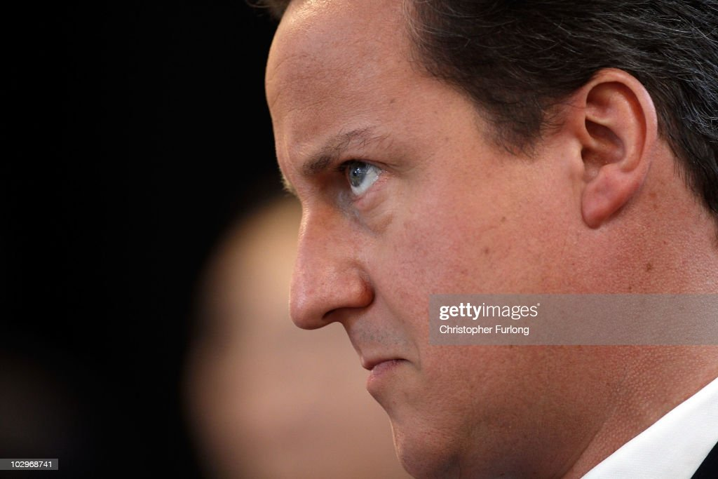 British Prime Minister David Cameron listens to speakers at the Creative Campus, Liverpool Hope University where he launched the 'Big Society' drive on July 19, 2010 in Liverpool, England. The idea of the big society was part of the Conservatives general election campaign and aims to put power back into the hands of the public running community and voluntary services.