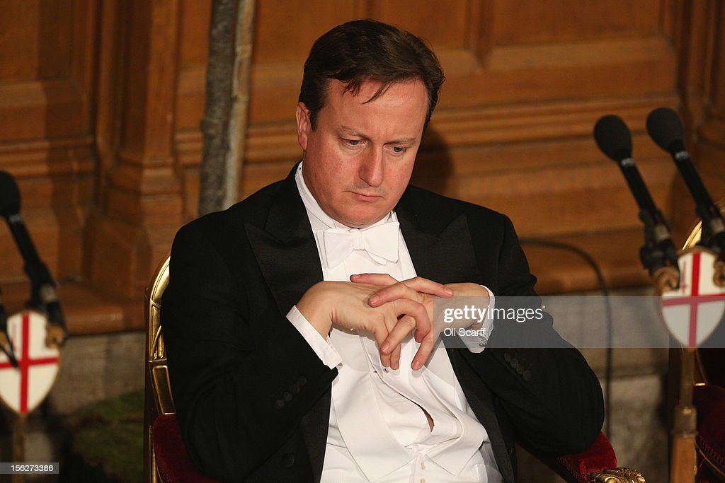 British Prime Minister <a gi-track='captionPersonalityLinkClicked' href=/galleries/search?phrase=David+Cameron+-+Politico&family=editorial&specificpeople=227076 ng-click='$event.stopPropagation()'>David Cameron</a> listens to the speeches in the Guildhall during The Lord Mayor's Banquet on November 12, 2012 in London, England. The New Lord Mayor of London Roger Gifford is hosting the annual Lord Mayor's Banquet in London's Guildhall which will feature speeches from the Prime Minister and the Archbishop of Canterbury.
