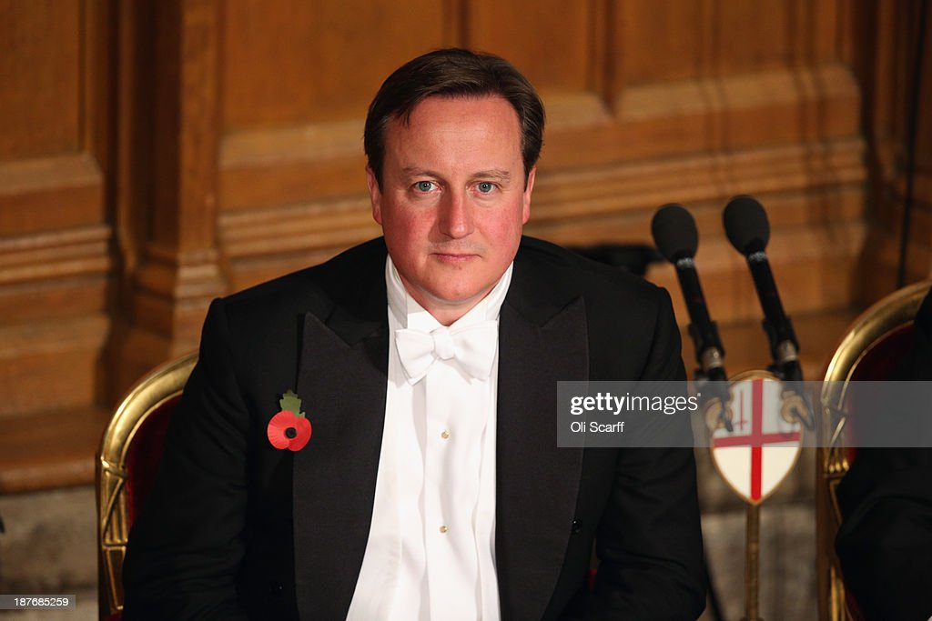 British Prime Minister <a gi-track='captionPersonalityLinkClicked' href=/galleries/search?phrase=David+Cameron+-+Politician&family=editorial&specificpeople=227076 ng-click='$event.stopPropagation()'>David Cameron</a> listens to the speeches in the Guildhall during The Lord Mayor's Banquet on November 11, 2013 in London, England. The New Lord Mayor of London Fiona Woolf is hosting the annual Lord Mayor's Banquet in London's Guildhall which will feature speeches from the Prime Minister and the Archbishop of Canterbury. Alderman Fiona Woolf has been elected as 686th Lord Mayor of the City of London and the second ever woman to hold the role.