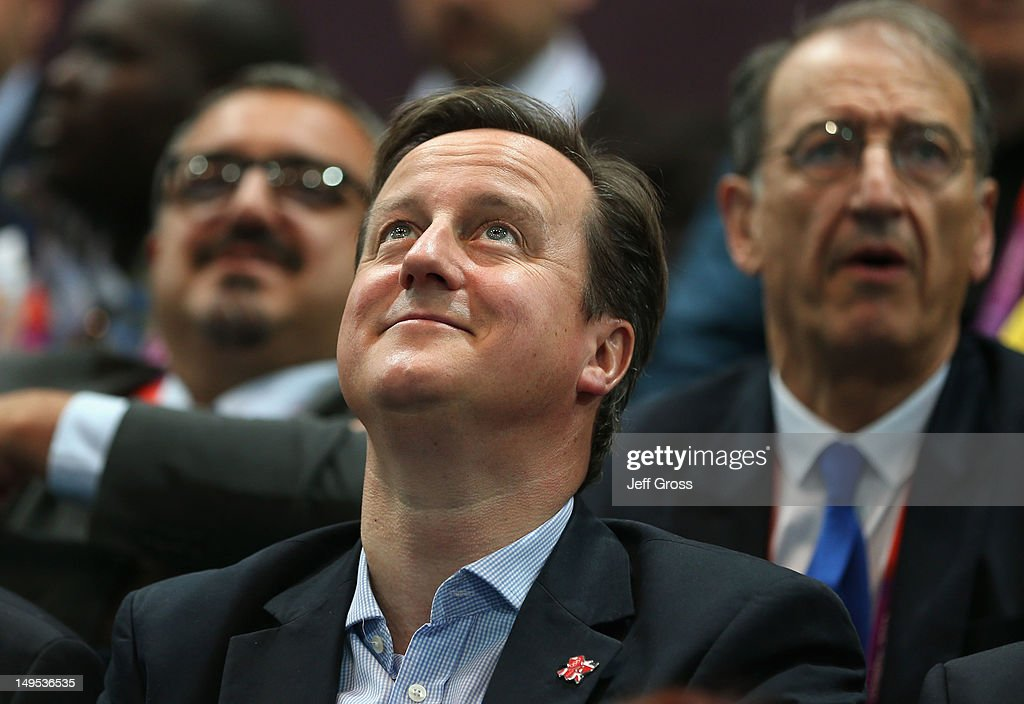 British Prime Minister <a gi-track='captionPersonalityLinkClicked' href=/galleries/search?phrase=David+Cameron+-+Politician&family=editorial&specificpeople=227076 ng-click='$event.stopPropagation()'>David Cameron</a> looks on during the Women's Handball Preliminaries Group B - Match 10 between France and Spain on Day 3 of the London 2012 Olympic Games at the Copper Box on July 30, 2012 in London, England.