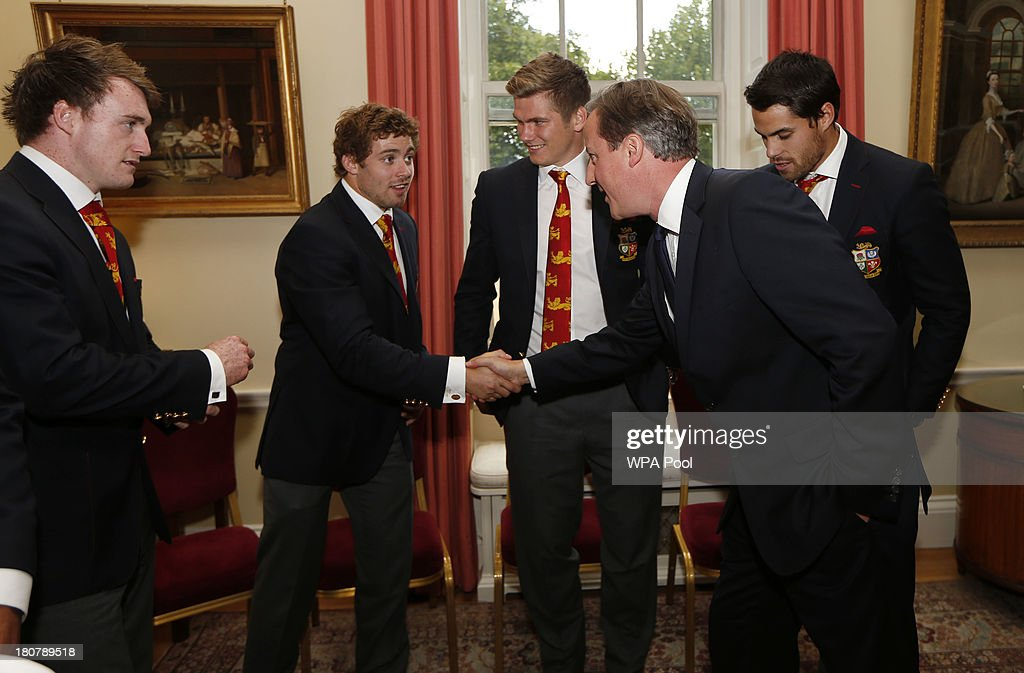 British Prime Minister <a gi-track='captionPersonalityLinkClicked' href=/galleries/search?phrase=David+Cameron+-+Politician&family=editorial&specificpeople=227076 ng-click='$event.stopPropagation()'>David Cameron</a>, (R) meets British Lions players Jonathan Davies, (L) <a gi-track='captionPersonalityLinkClicked' href=/galleries/search?phrase=Leigh+Halfpenny&family=editorial&specificpeople=4232760 ng-click='$event.stopPropagation()'>Leigh Halfpenny</a>, (2nd L) <a gi-track='captionPersonalityLinkClicked' href=/galleries/search?phrase=Owen+Farrell&family=editorial&specificpeople=4809668 ng-click='$event.stopPropagation()'>Owen Farrell</a>, (C) and <a gi-track='captionPersonalityLinkClicked' href=/galleries/search?phrase=Sean+Maitland&family=editorial&specificpeople=4444184 ng-click='$event.stopPropagation()'>Sean Maitland</a> during an official reception at Downing Street on September 16, 2013 in London, England. The reception was to mark the British Lions victorious tour of Australia in the summer.
