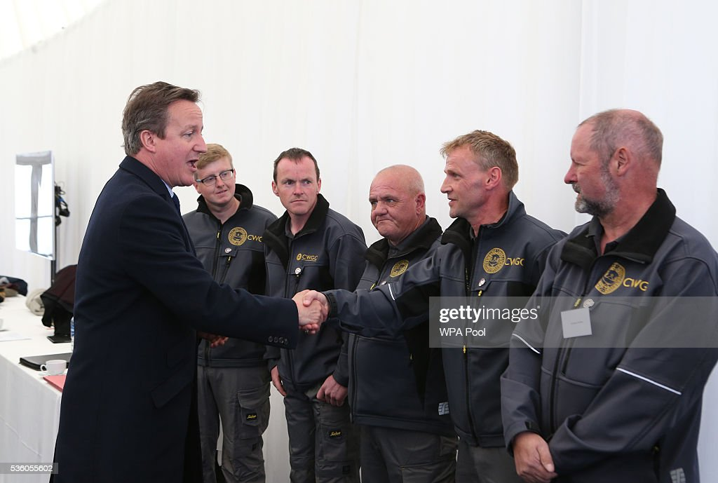 British Prime Minister David Cameron meets gardeners from the Commonwealth War Graves Commission after attending a service during the 100th anniversary commemorations for the Battle of Jutland on May 31, 2016 in Hoy, Scotland. The event marks the centenary of the largest naval battle of World War One where more than 6,000 Britons and 2,500 Germans died in the Battle of Jutland fought near the coast of Denmark on 31 May and 1 June 1916.