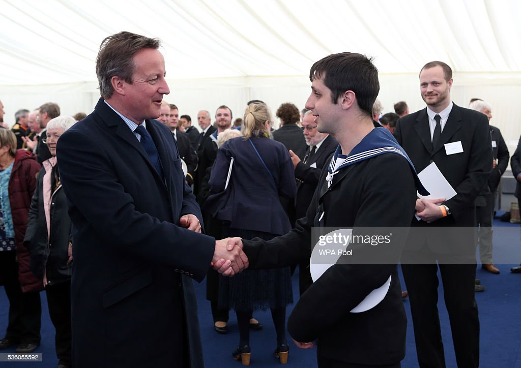 British Prime Minister <a gi-track='captionPersonalityLinkClicked' href=/galleries/search?phrase=David+Cameron+-+Politician&family=editorial&specificpeople=227076 ng-click='$event.stopPropagation()'>David Cameron</a> meets navy personnel after attending a service during the 100th anniversary commemorations for the Battle of Jutland on May 31, 2016 in Hoy, Scotland. The event marks the centenary of the largest naval battle of World War One where more than 6,000 Britons and 2,500 Germans died in the Battle of Jutland fought near the coast of Denmark on 31 May and 1 June 1916.