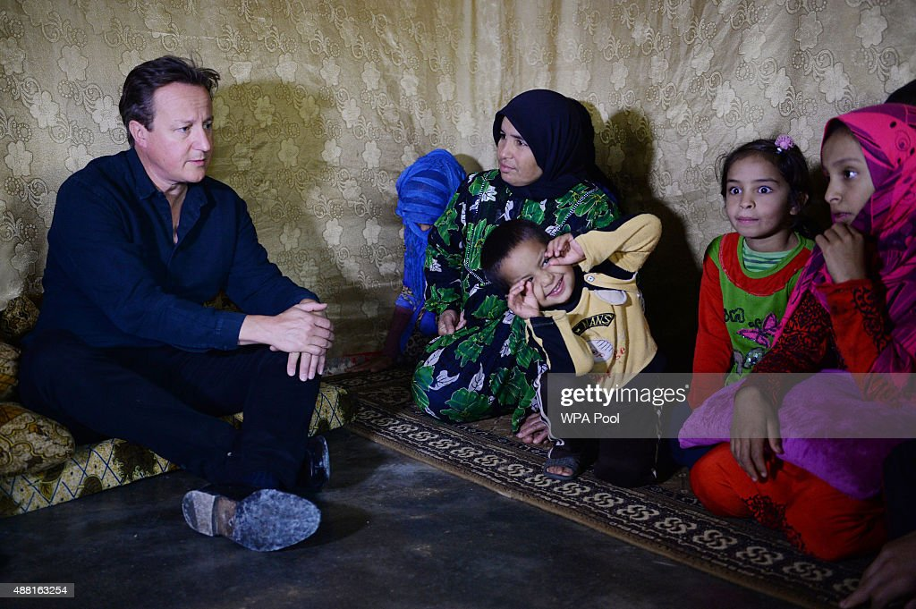 British Prime Minister David Cameron meets Syrian refugee families at a tented settlement camp on September 14, 2015 in the Bekaa Valley, on the Syrian border with Lebanon. Mr Cameron is in the region to see conditons and meet those who have fled their homes in Syria.