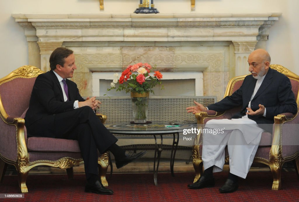 British Prime Minister David Cameron meets with Afghan President Hamid Karzai at the Presidential Palace on July 19 2012 in Kabul Afghanistan The...