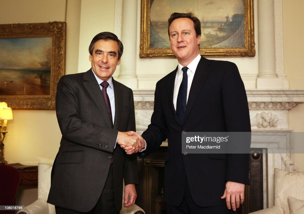 British Prime Minister <a gi-track='captionPersonalityLinkClicked' href=/galleries/search?phrase=David+Cameron+-+Politico&family=editorial&specificpeople=227076 ng-click='$event.stopPropagation()'>David Cameron</a> (R) meets with French Prime Minister Francois Fillon at 10 Downing Street on January 13, 2011 in London, England. Mr. Fillon is in the United Kingdom on a two day visit.