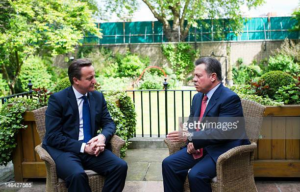 British Prime Minister David Cameron meets with King Abdullah II of Jordan on the terrace in the gardens of Downing Street on June 16 2012 in London...