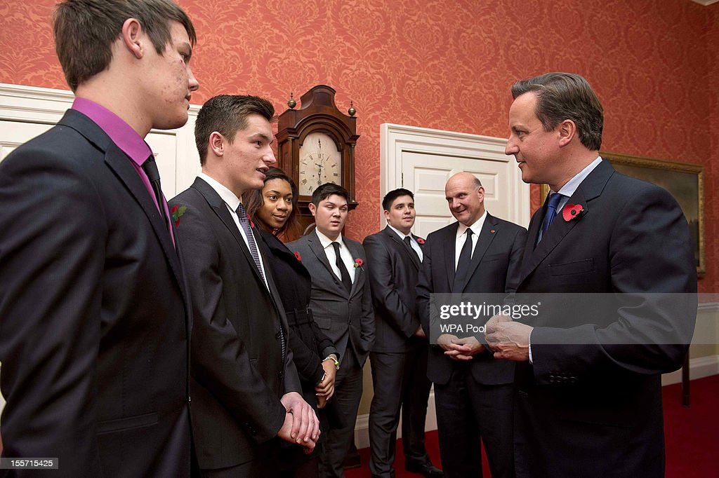 British Prime Minister <a gi-track='captionPersonalityLinkClicked' href=/galleries/search?phrase=David+Cameron+-+Politician&family=editorial&specificpeople=227076 ng-click='$event.stopPropagation()'>David Cameron</a> meets with Microsoft CEO <a gi-track='captionPersonalityLinkClicked' href=/galleries/search?phrase=Steve+Ballmer&family=editorial&specificpeople=211258 ng-click='$event.stopPropagation()'>Steve Ballmer</a> (2ndR) and young members of Microsoft's Get On programme at 10 Downing Street on November 7, 2012 in London, England. Microsoft is aiming to give 300,000 young unemployed people help with the skills and inspiration needed to gain their first job.