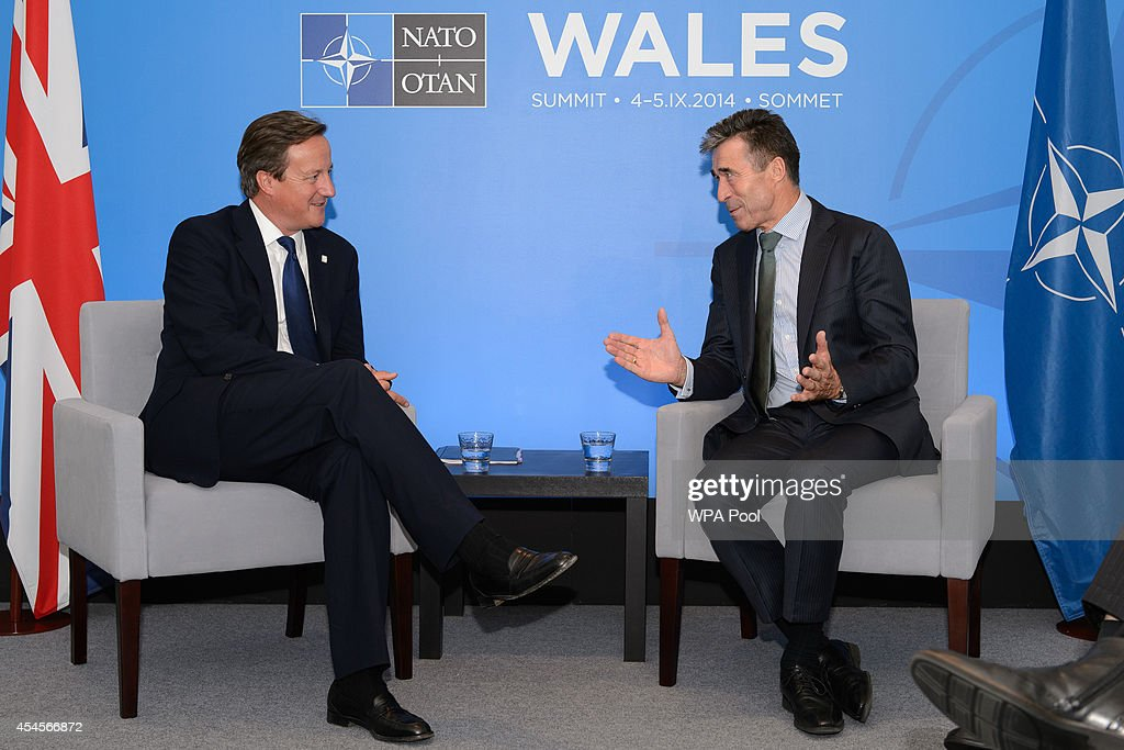 British Prime Minister <a gi-track='captionPersonalityLinkClicked' href=/galleries/search?phrase=David+Cameron+-+Politician&family=editorial&specificpeople=227076 ng-click='$event.stopPropagation()'>David Cameron</a> (L) meets with NATO Secretary General <a gi-track='captionPersonalityLinkClicked' href=/galleries/search?phrase=Anders+Fogh+Rasmussen&family=editorial&specificpeople=549374 ng-click='$event.stopPropagation()'>Anders Fogh Rasmussen</a> at the Celtic Manor Resort on September 3, 2014 in Newport, Wales, United Kingdom. Some 67 world leaders will be attending the NATO summit at Celtic Manor September 4-5.