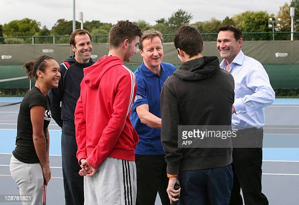 British Prime Minister David Cameron meets with young British players Heather Watson George Morgan and Ollie Golding with tennis player Greg Rusedski...