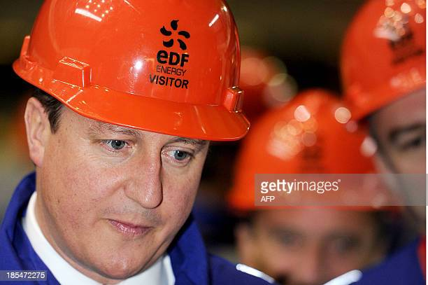 British Prime Minister David Cameron meets workers in the Charge Hall at Hinkley Point B on October 21 French energy giant EDF said on Monday it had...