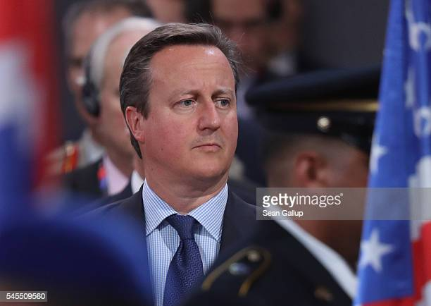 British Prime Minister David Cameron observes a ceremony to honour NATO soldiers killed in the line of duty prior to the meeting of the North...
