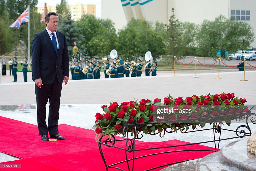 British Prime Minister <a gi-track='captionPersonalityLinkClicked' href=/galleries/search?phrase=David+Cameron+-+Politician&family=editorial&specificpeople=227076 ng-click='$event.stopPropagation()'>David Cameron</a> pays his respects after laying a wreath at the Monument of the Motherland Defenders on July 1, 2013 in Astana, Kazakhstan. Cameron is visiting Kazakhstan as part of a trade mission; the first ever trip to the country by a serving British Prime Minister, after making an unannounced trip to visit troops in Afghanistan and meeting with the Prime Minister of Pakistan in Islamabad.