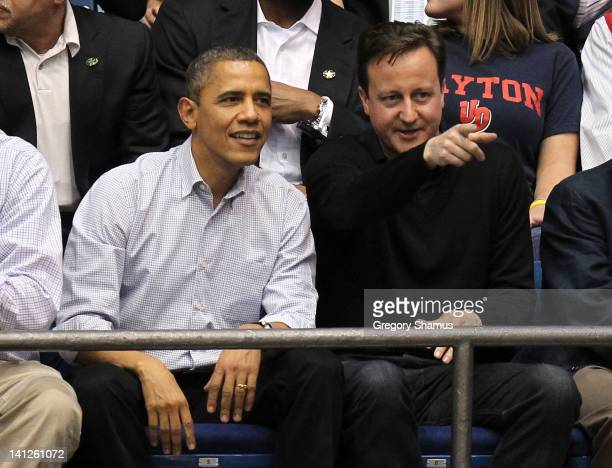 British Prime Minister David Cameron points as he talks with US President Barack Obama points as he talks with at UD Arena as the Western Kentucky...