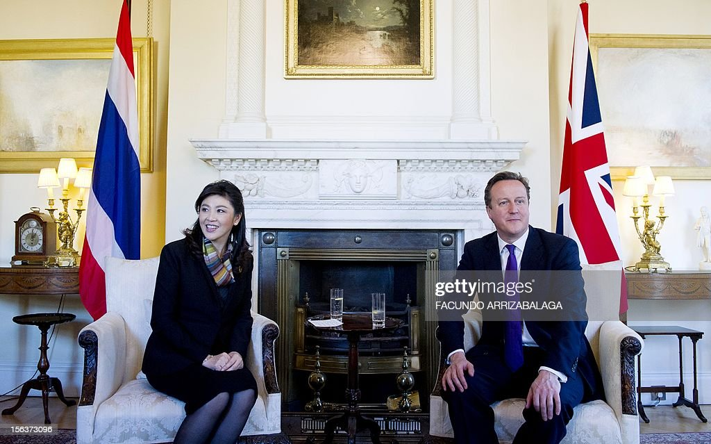 British Prime Minister, David Cameron (R) poses for a photograph with Prime Minister of Thailand Yingluck Shinawatra (L) at Number10 Downing Street in London on November 14, 2012. Yingluck Shinawatra is on an official visit to Britain during which she has met with Queen Elizabeth II and Prime Minister David Cameron.
