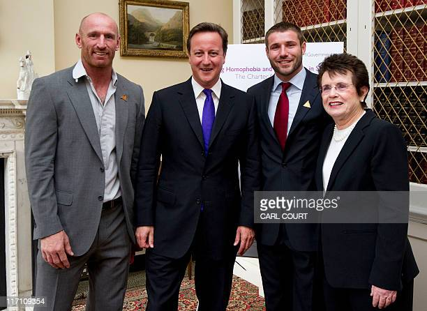 British Prime Minister David Cameron poses for a photograph with former rugby players Gareth Thomas and Ben Cohen and former tennis player Billie...