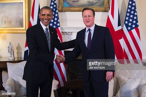 British Prime Minister David Cameron poses for pictures with US President Barack Obama before a meeting in 10 Downing Street in central London on...