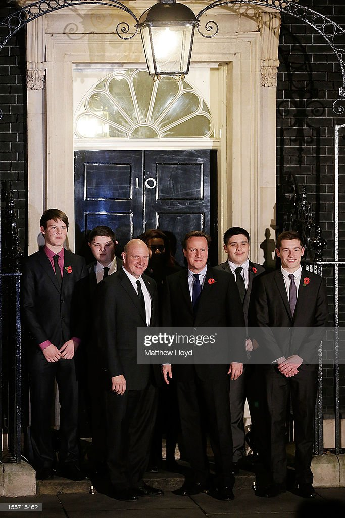 British Prime Minister <a gi-track='captionPersonalityLinkClicked' href=/galleries/search?phrase=David+Cameron+-+Politiker&family=editorial&specificpeople=227076 ng-click='$event.stopPropagation()'>David Cameron</a> poses with Microsoft CEO <a gi-track='captionPersonalityLinkClicked' href=/galleries/search?phrase=Steve+Ballmer&family=editorial&specificpeople=211258 ng-click='$event.stopPropagation()'>Steve Ballmer</a> (3rdL) and young members of Microsoft's Get On programme at 10 Downing Street on November 7, 2012 in London, England. Microsoft is aiming to give 300,000 young unemployed people help with the skills and inspiration needed to gain their first job.