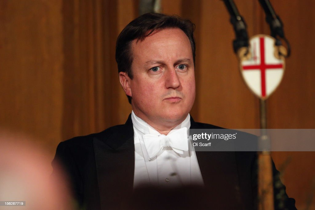 British Prime Minister <a gi-track='captionPersonalityLinkClicked' href=/galleries/search?phrase=David+Cameron+-+Politiker&family=editorial&specificpeople=227076 ng-click='$event.stopPropagation()'>David Cameron</a> prepares to deliver a speech to guests in the Guildhall during The Lord Mayor's Banquet on November 12, 2012 in London, England. The New Lord Mayor of London Roger Gifford is hosting the annual Lord Mayor's Banquet in London's Guildhall which will feature speeches from the Prime Minister and the Archbishop of Canterbury.