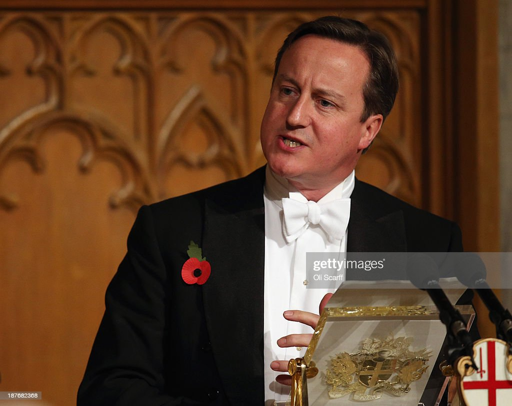British Prime Minister <a gi-track='captionPersonalityLinkClicked' href=/galleries/search?phrase=David+Cameron+-+Politician&family=editorial&specificpeople=227076 ng-click='$event.stopPropagation()'>David Cameron</a> prepares to deliver his speech in the Guildhall during The Lord Mayor's Banquet on November 11, 2013 in London, England. The New Lord Mayor of London Fiona Woolf is hosting the annual Lord Mayor's Banquet in London's Guildhall which will feature speeches from the Prime Minister and the Archbishop of Canterbury. Alderman Fiona Woolf has been elected as 686th Lord Mayor of the City of London and the second ever woman to hold the role.