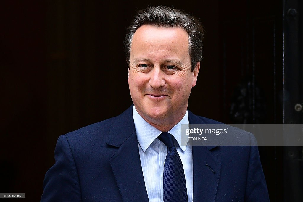 British Prime Minister David Cameron reacts as he departs 10 Downing Street enroute to the Houses of Parliament in central London on June 27, 2016. The British government on Monday agreed to establish a new civil service unit that will have the complex task of negotiating the country's departure from the European Union, outgoing Prime Minister David Cameron's spokeswoman said. London stocks extended their losses in early afternoon Monday, led by banking, airline and property shares, following Britain's vote to leave the EU. / AFP / LEON