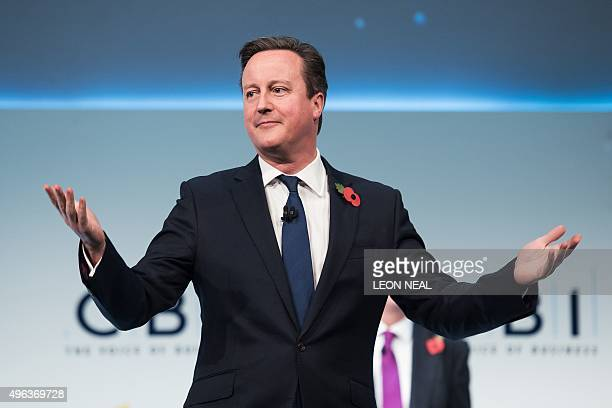 British Prime Minister David Cameron reacts as he is interrupted by hecklers during his address to delegates at the annual Confederation of British...