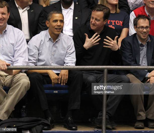 British Prime Minister David Cameron reacts as he talks with US President Barack Obama at UD Arena as the Western Kentucky Hilltoppers take on the...