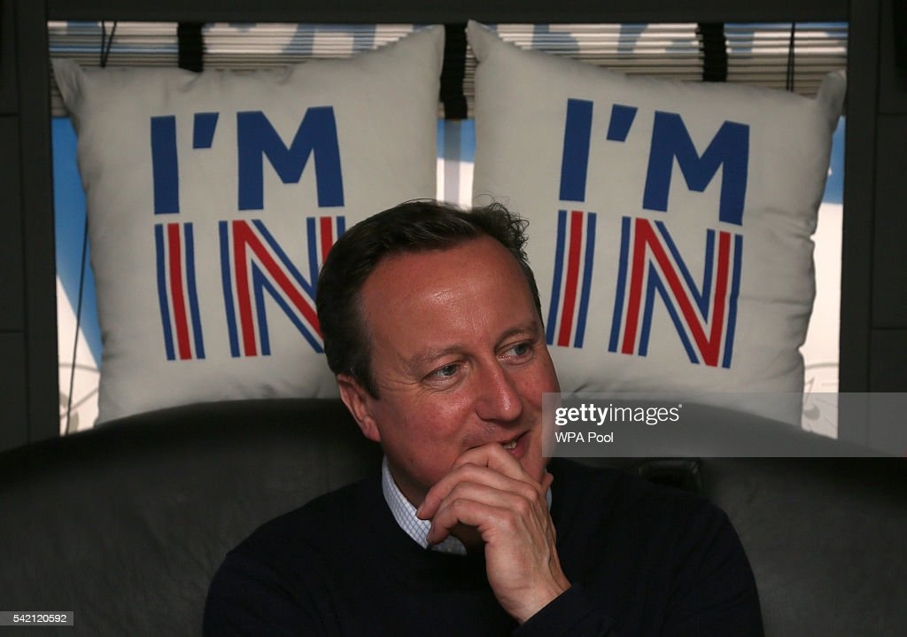 British Prime Minister David Cameron reacts as he travels on his campaign bus from Bristol on June 22, 2016 in Bristol, United Kingdom. The final day of campaigning continues across the UK as the country prepares to go to the polls on June 23rd to decide whether Britain should remain or leave the European Union.
