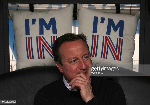 British Prime Minister David Cameron reacts as he travels on his campaign bus from Bristol on June 22 2016 in Bristol United Kingdom The final day of...