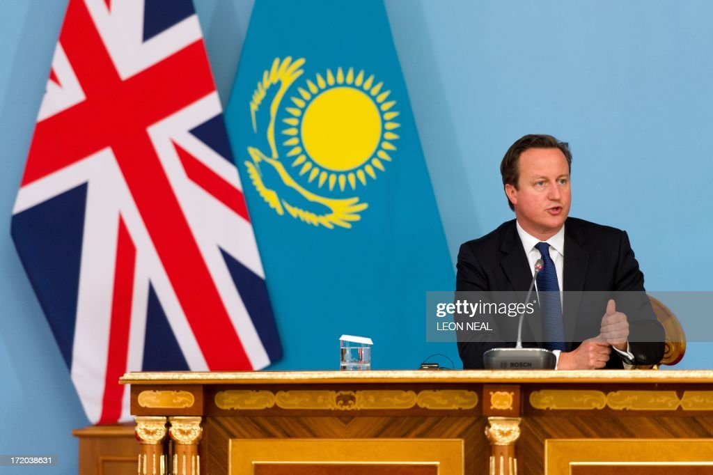 British Prime Minister David Cameron responds to questions during a joint press conference with President Nursultan Nazarbayev (not pictured) after signing a strategic partnership agreement at the Presidential Palace in Astana, Kazakhstan on July 1, 2013. David Cameron arrived in Kazakhstan on June 30, 2013 on the first ever trip by a serving British prime minister, hoping to boost trade ties but also promising to raise human rights concerns.