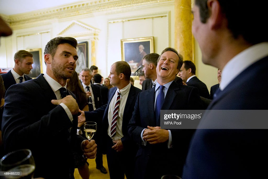 British Prime Minister <a gi-track='captionPersonalityLinkClicked' href=/galleries/search?phrase=David+Cameron+-+Politician&family=editorial&specificpeople=227076 ng-click='$event.stopPropagation()'>David Cameron</a>, second right, laughs as he chats with England bowler Jimmy Anderson, left, flanked by captain <a gi-track='captionPersonalityLinkClicked' href=/galleries/search?phrase=Alastair+Cook+-+Cricket+Player&family=editorial&specificpeople=571475 ng-click='$event.stopPropagation()'>Alastair Cook</a>, right foreground, during a reception to mark a successful summer of cricket at 10 Downing Street on September 21, 2015 in London, England.