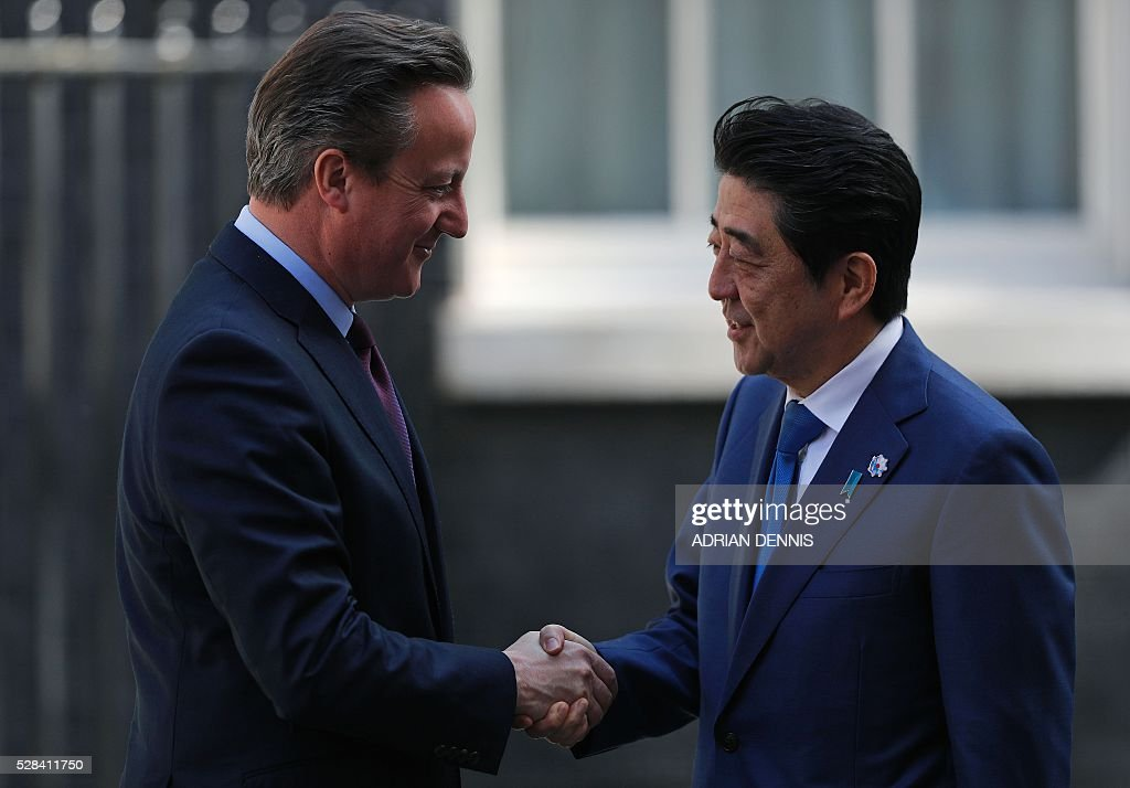 British Prime Minister David Cameron (L) shakes hands as he greets Japanese Prime Minister Shinzo Abe outside 10 Downing Street in central London on May 5, 2016, ahead of their meeting. / AFP / ADRIAN