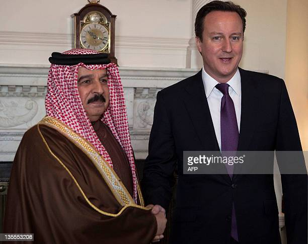 British Prime Minister David Cameron shakes hands with Bahrain's King Hamad bin Issa alKhalifa during their meeting at 10 Downing Street in London on...