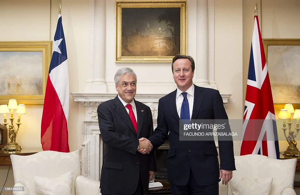 British Prime Minister, David Cameron (R) shakes hands with Chilean President, Sebastian Pinera (L) inside Number 10 Downing Street in London on November 15, 2012.