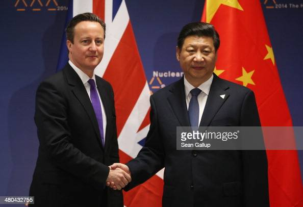 British Prime Minister David Cameron shakes hands with Chinese President Xi Jinping before bilateral talks at the 2014 Nuclear Security Summit on...
